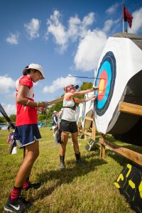 Women and girls are flocking to archery in recent years. Some experts attribute the sport's growth to films such as 'Hunger Games' and 'Brave.' PHOTO CREDIT: Teresa Johnson Photography