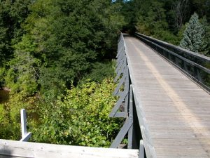The Musketawa Trail runs for 25 miles between Marne and Muskegon and features 13 wooden trestle bridges. Photo Credit: Friends of Musketawa Trails
