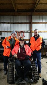 Vietnam War veteran Billy Myer, center, was able to get back outdoors again with the help of MiOFO. More than 20 guides are trained to assist those with health challenges in their outdoor adventures. PHOTO CREDIT: Michigan Operation Freedom Outdoors