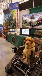 When Program Coordinator Tom Jones is out promoting MiOFO among outdoorsmen, his service dog Baxter always comes along for the ride, too. PHOTO CREDIT: Michigan Operation Freedom Outdoors