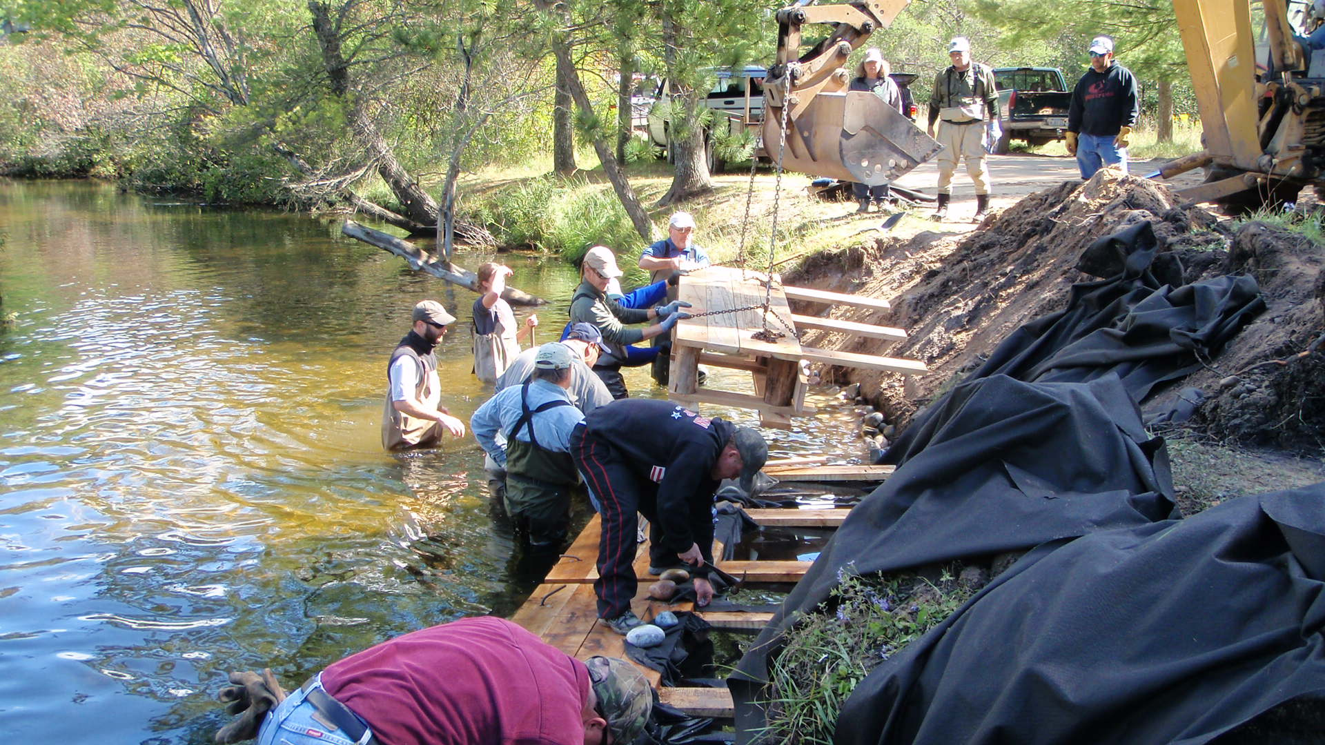 Lunker structure being installed at Pollack Bridge on the Au Sable River