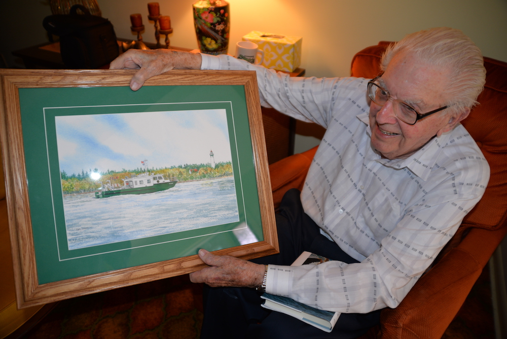 Howard Tanner shows off a painting of the Research Vessel Tanner