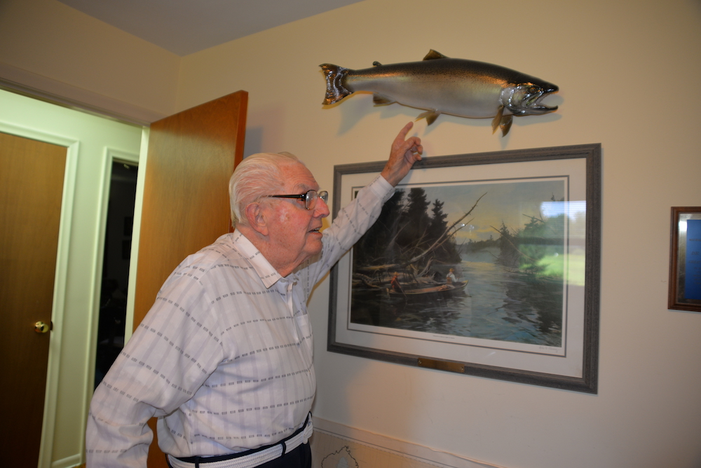 Howard Tanner shows off a mounted steelhead trout