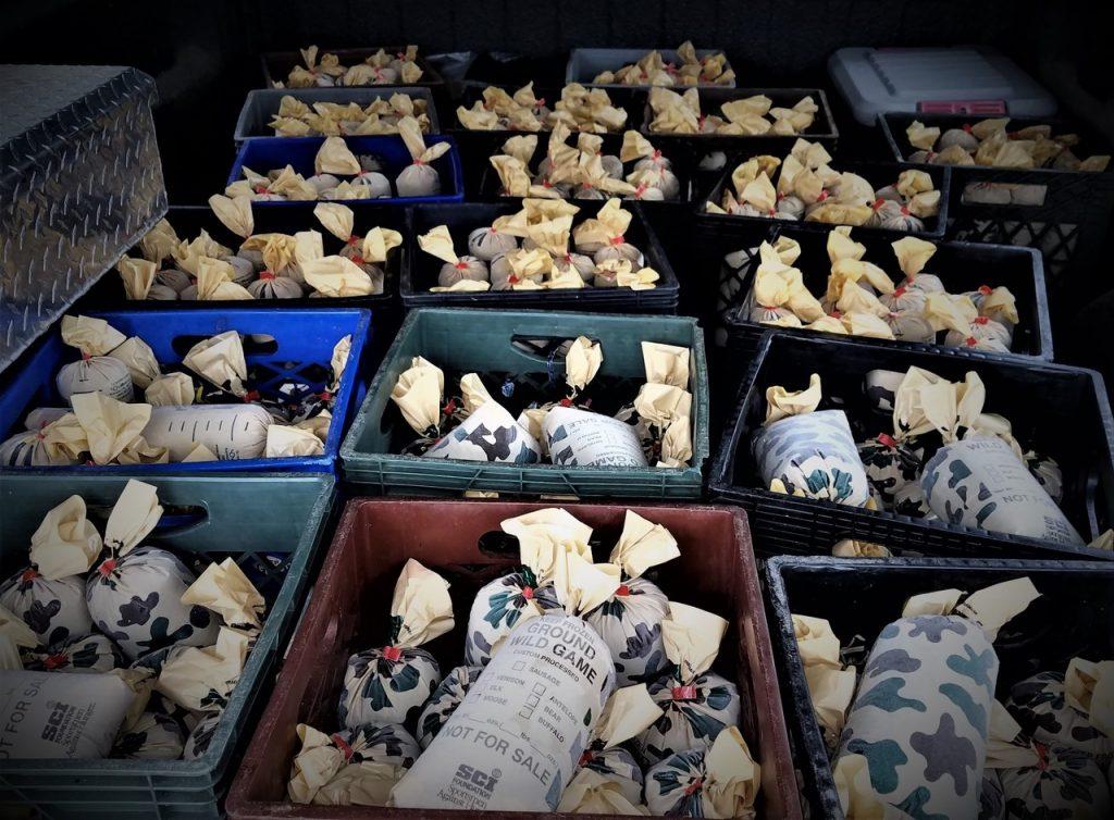 Boxes of frozen venison in bags