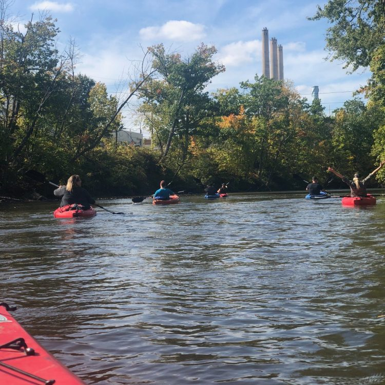 A first-person view, paddling down the Grand River in a kayak