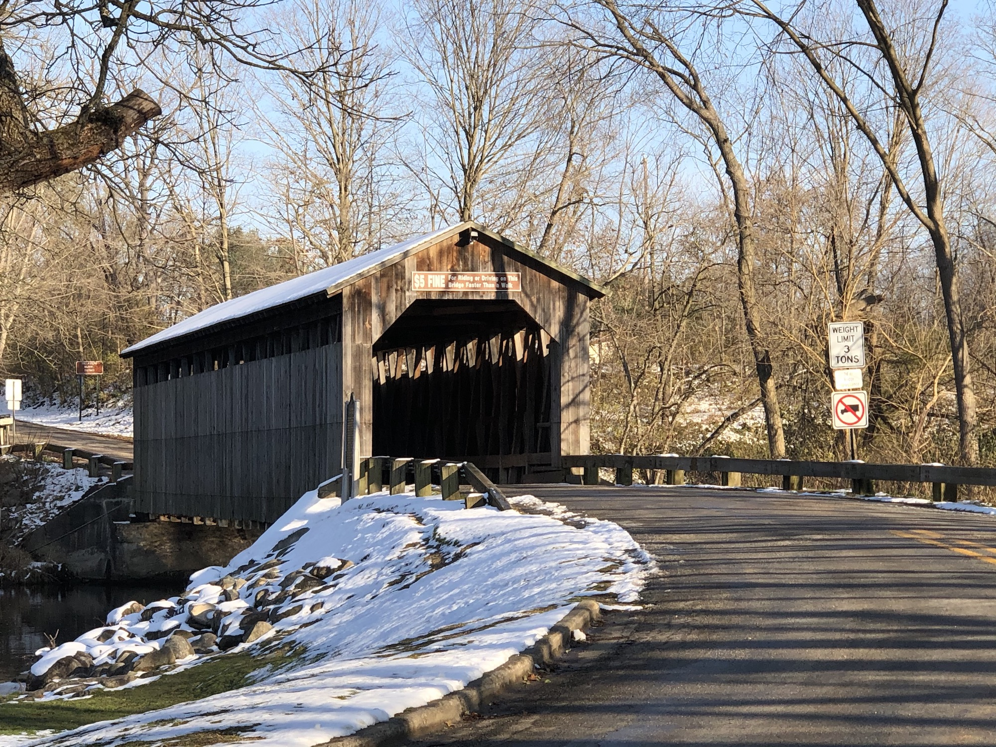 Wooden covered bridge during early winter