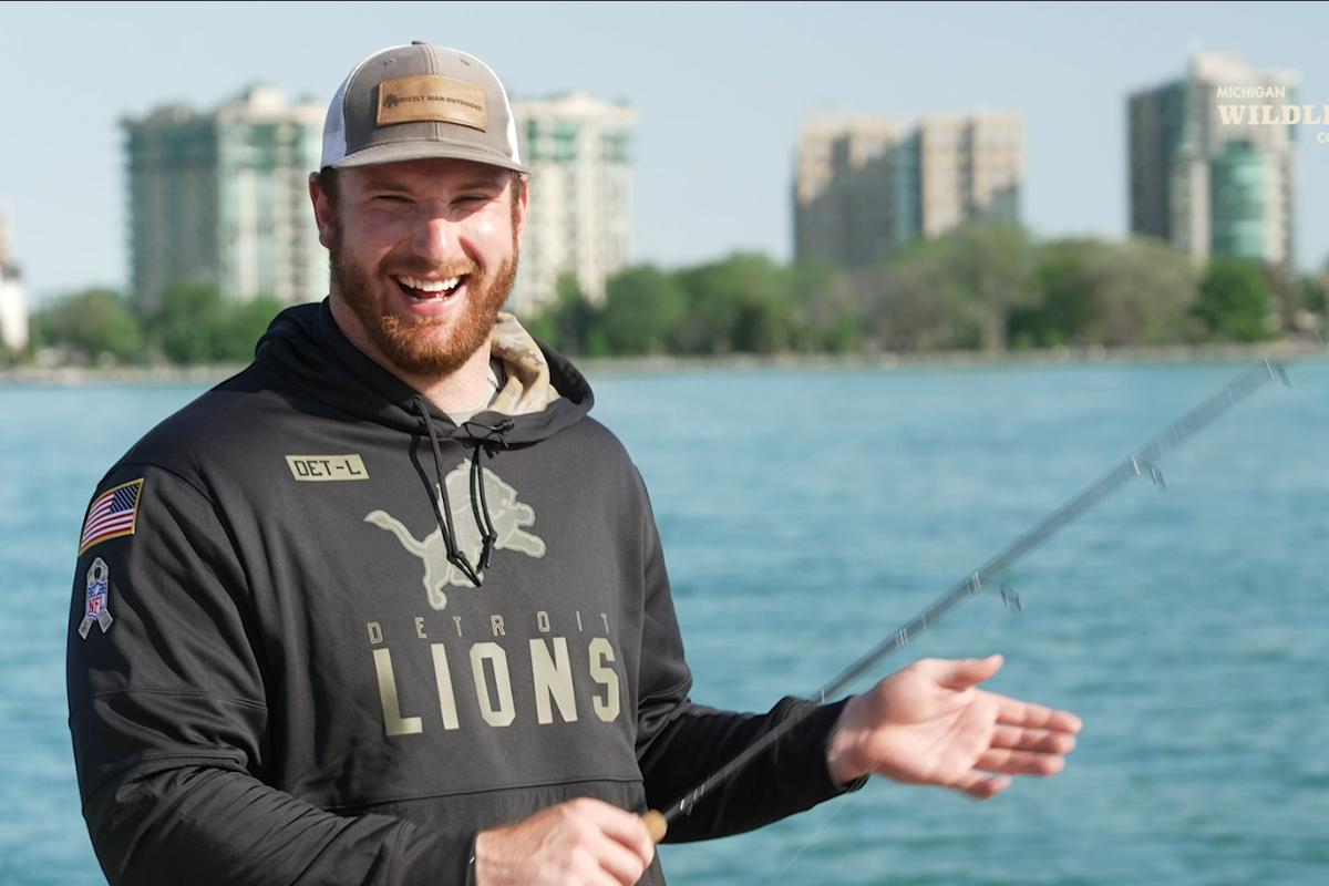 Detroit Lions Center Frank Ragnow fishing on the Detroit River